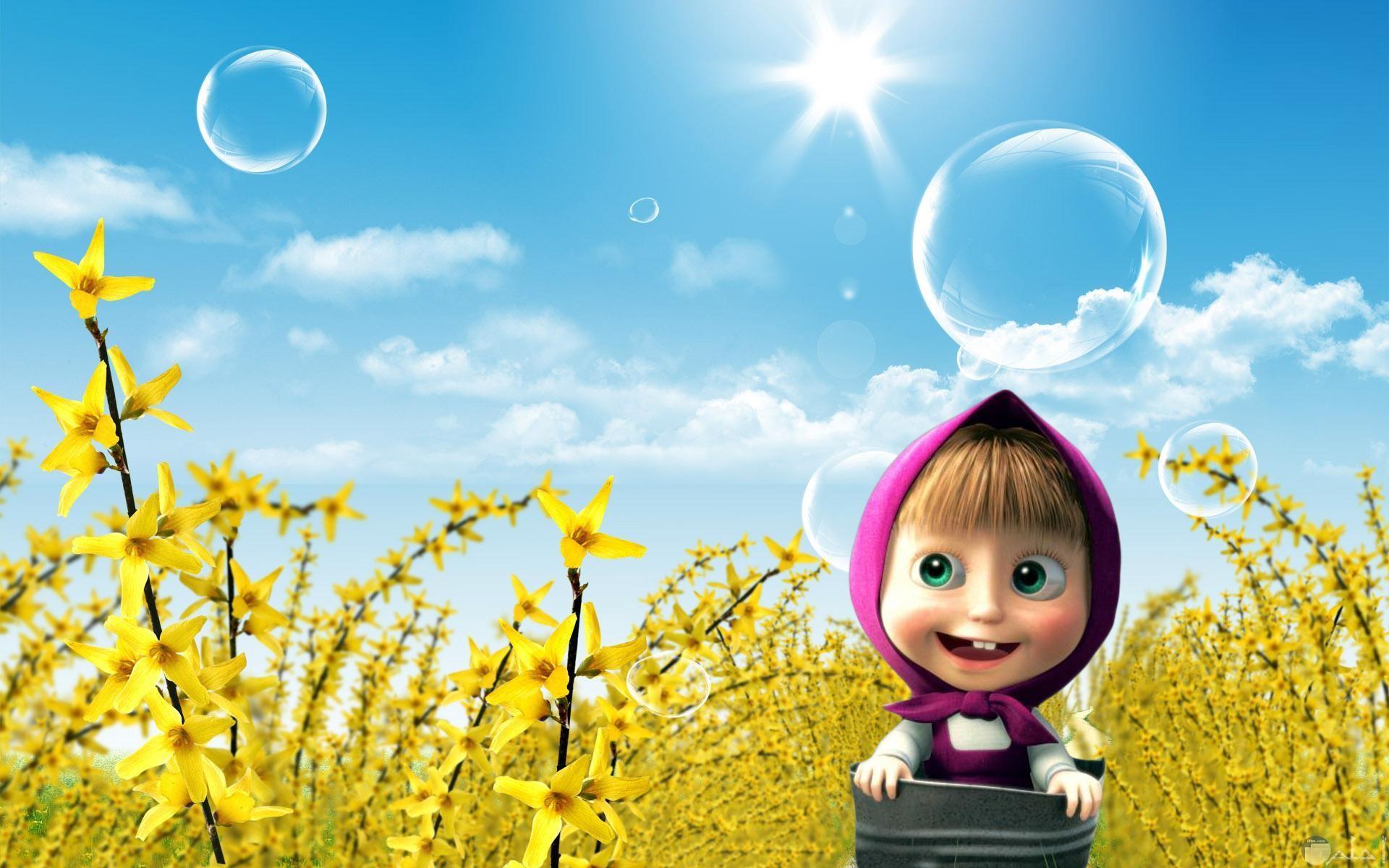صورة لماشا جميلة في جو مشمس وخلفها زهور صفراء اللون