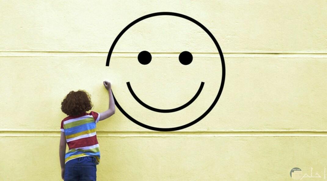 طفل يرسم الابتسامة