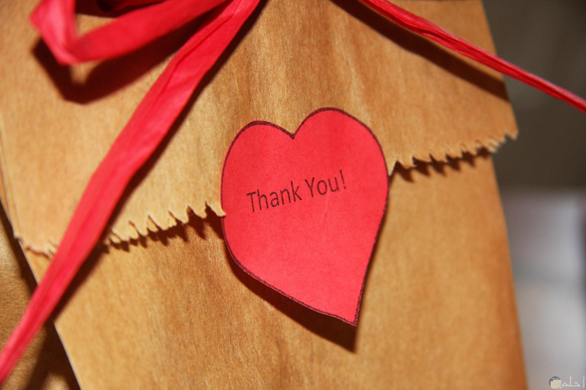 صورة جميلة لشكرا بالإنجليزي للأصدقاء مكتوبة علي قلب أحمر حلو ملصقة علي ظرف