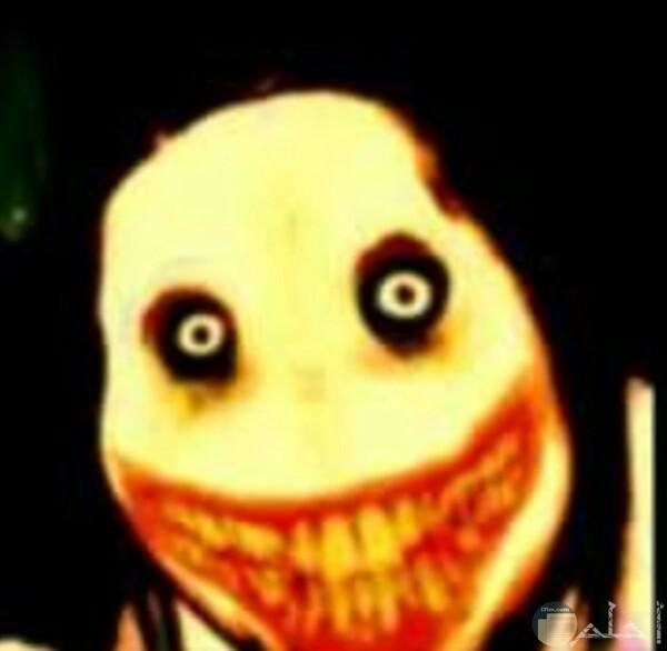 صورة مخيفة جدا لوجه شخص مرعب جدا وضحكته وعينيه تخوف