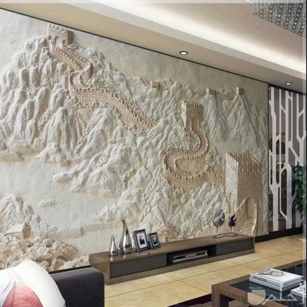 حائط بها حفر رسمه جبال وطريق ومبني