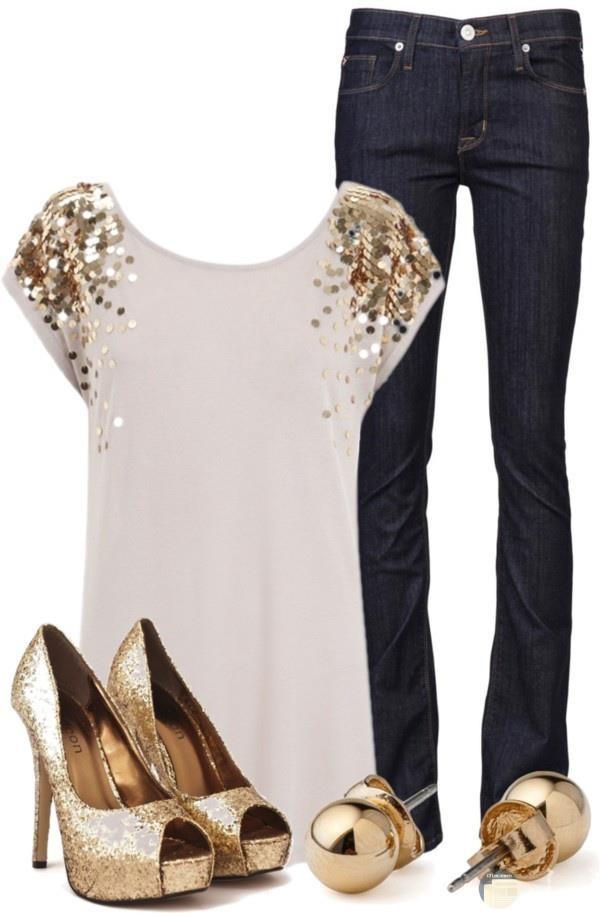 بنطلون جينز وبلوزة بيضاء بلمات ذهبية