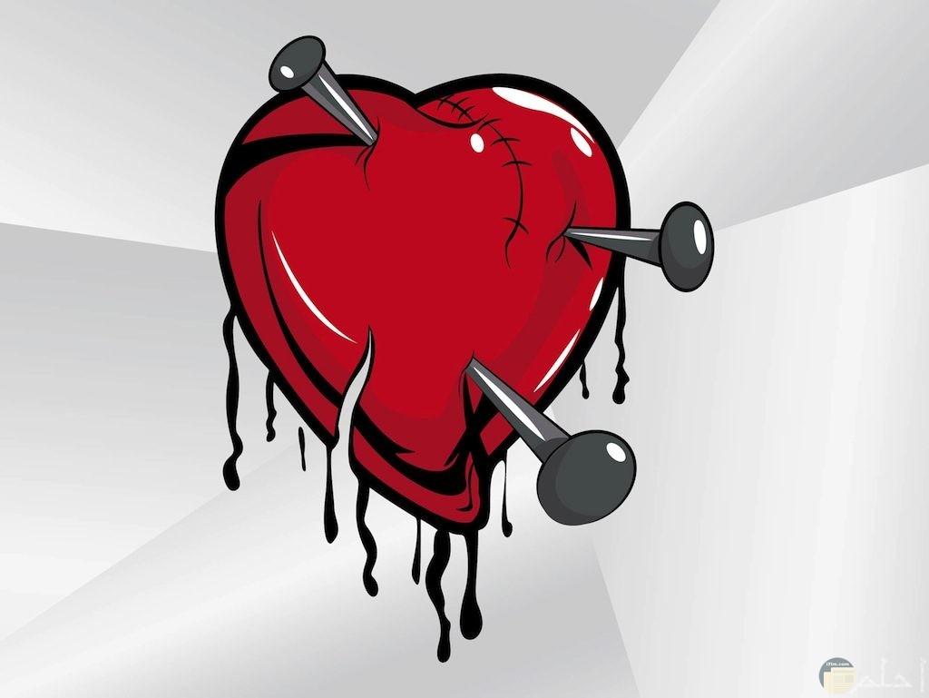 قلب ينزف به مسامير
