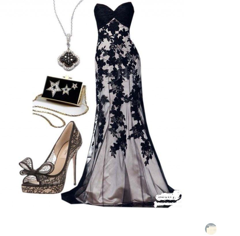 فستان طويل أسود و أبيض مع الإكسسوار المناسب له.