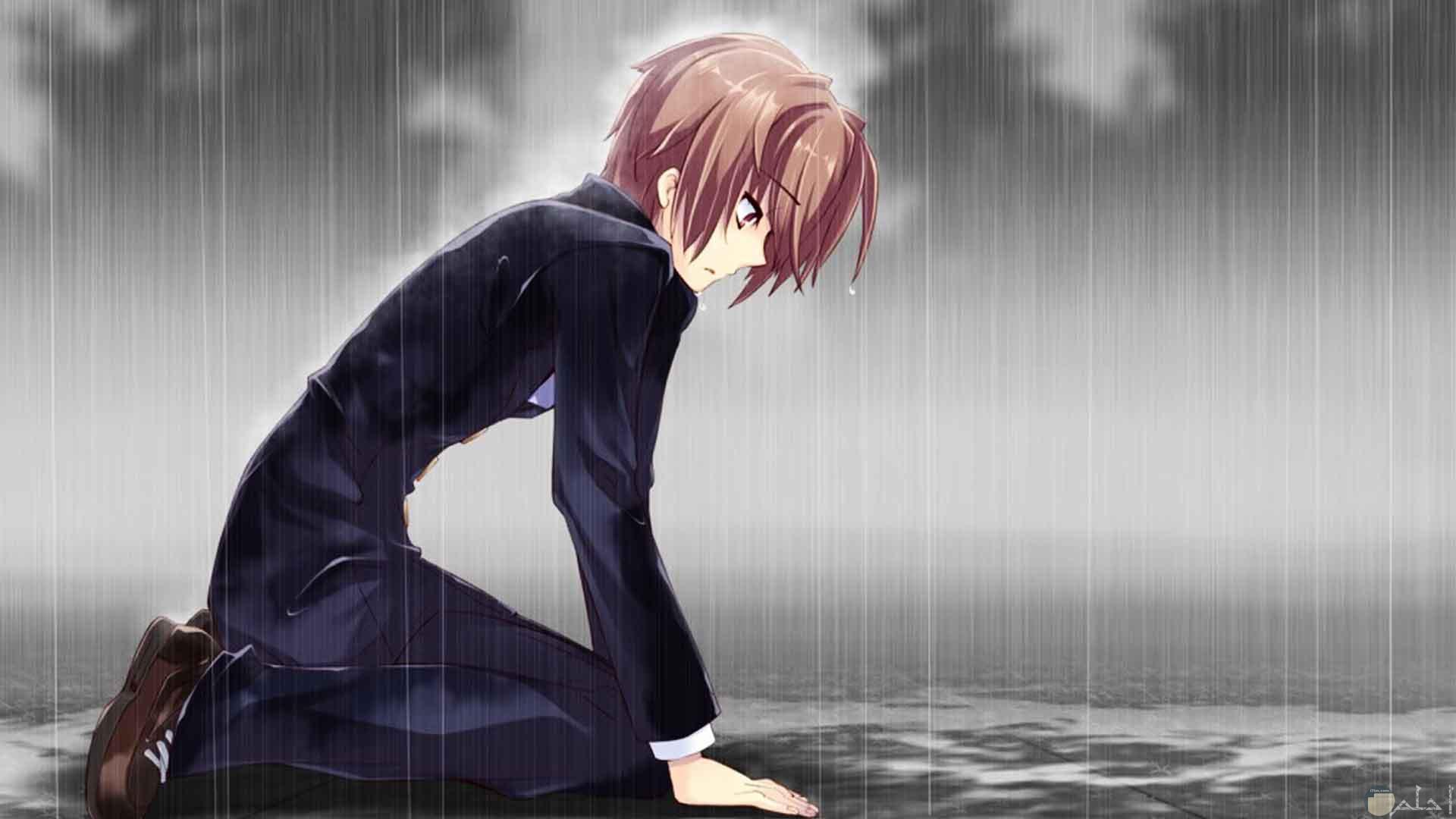 ولد انمي حزين و سط المطر.