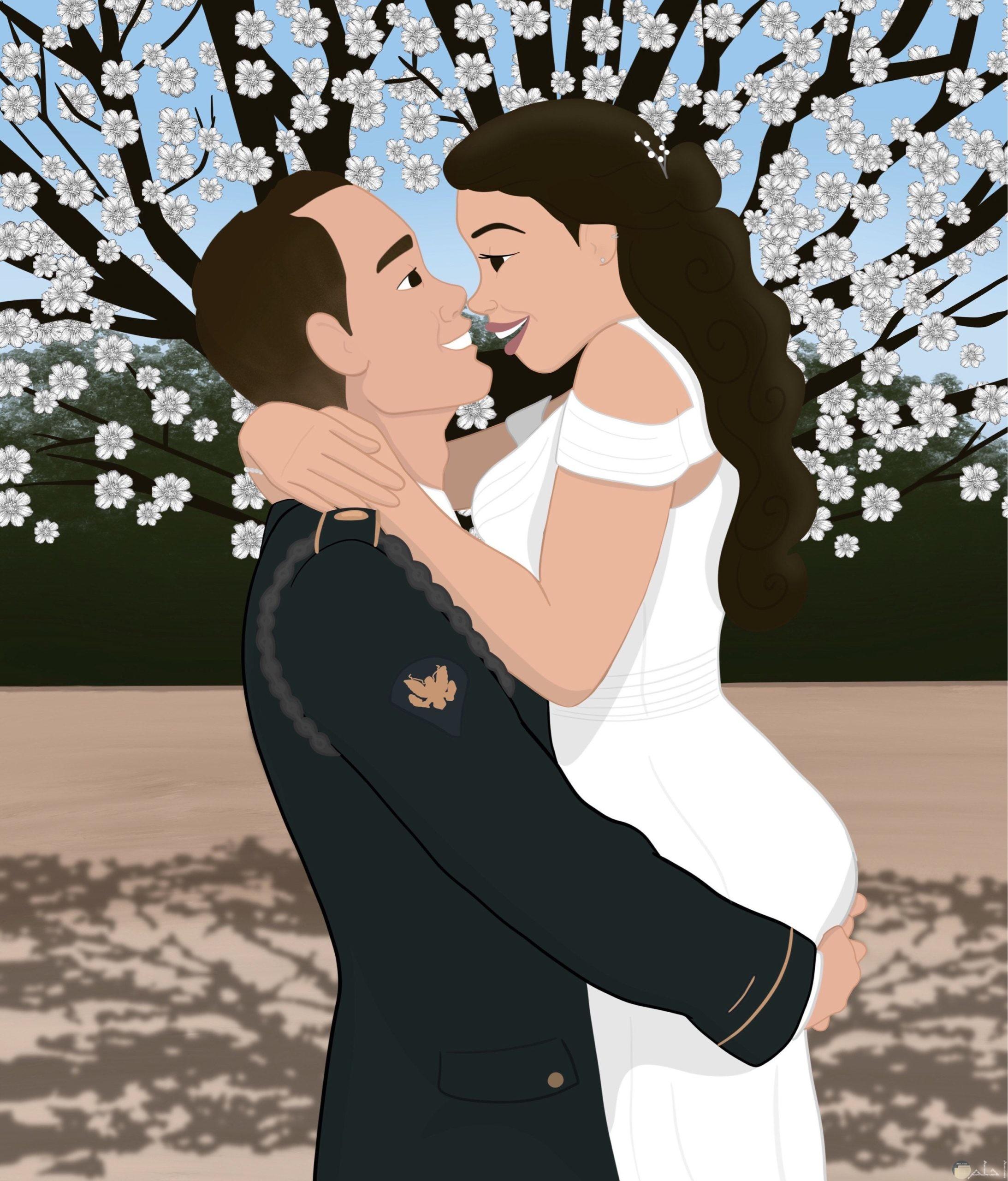 صورة لعريس يحمل عروسته.