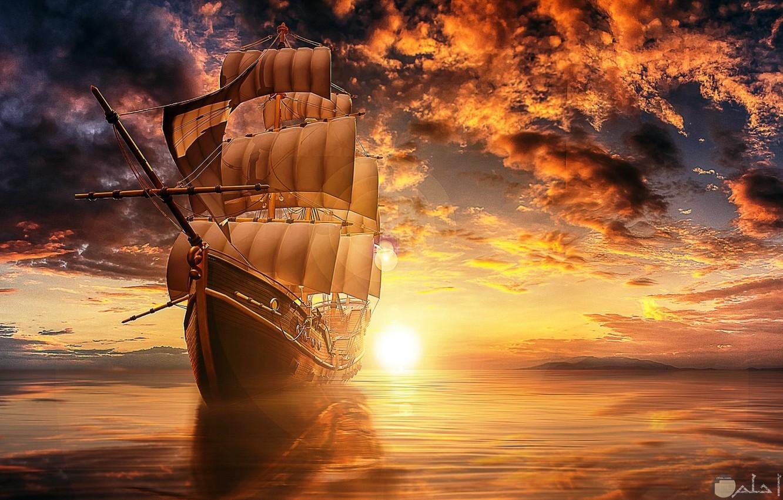سفينة شراعية كبيرة وقت الغروب.