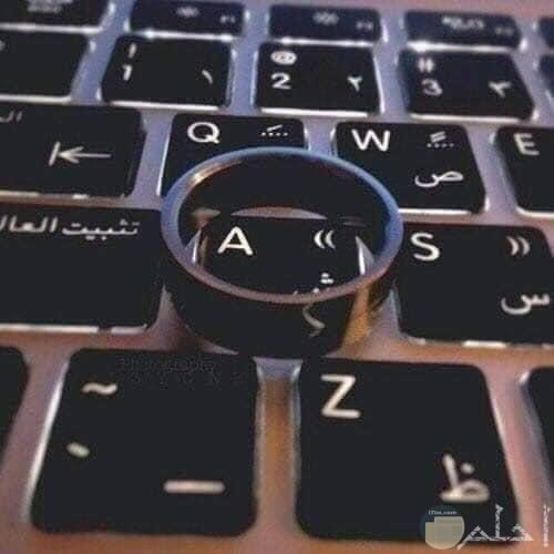 حرف A مع خاتم الزواج
