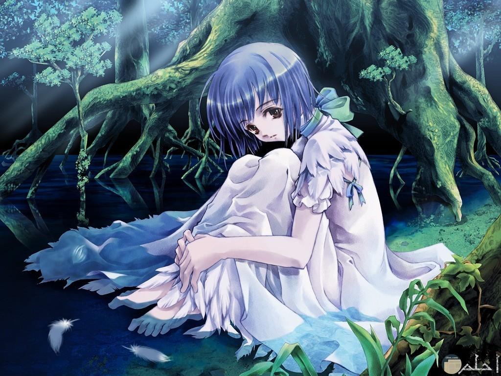 بنت انمى بفستان جميل جالسة بجوار شجرة